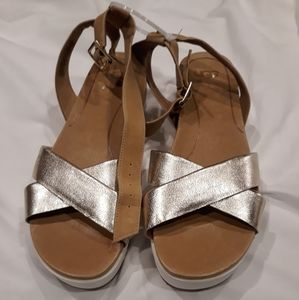 UGG Sandals Size 9.5. Gold color.